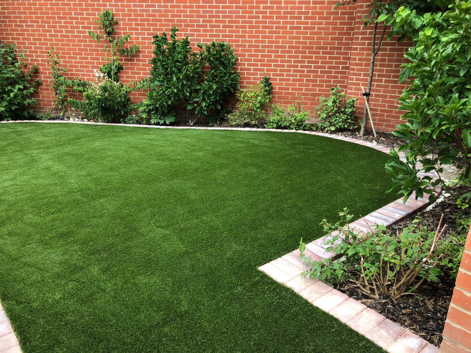 A stunning back garden with artificial grass installed